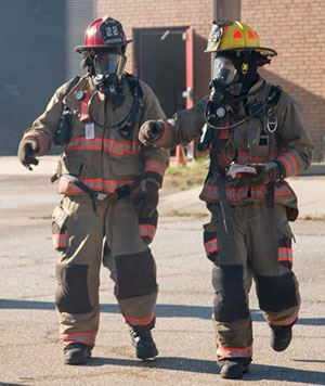 Two firefighters wearing turnout gear